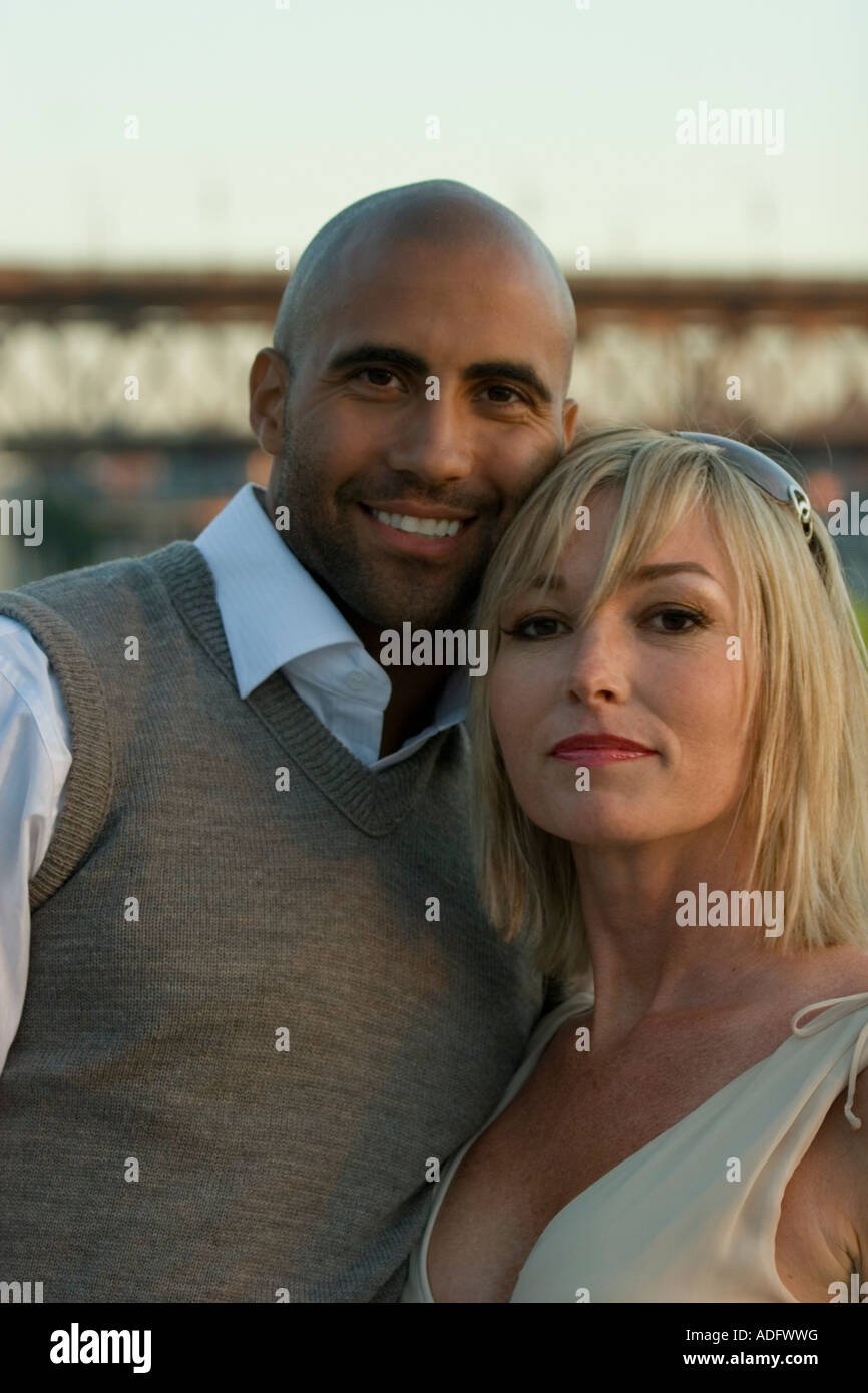 Close-up of a black man and a white woman couple. - Stock Image