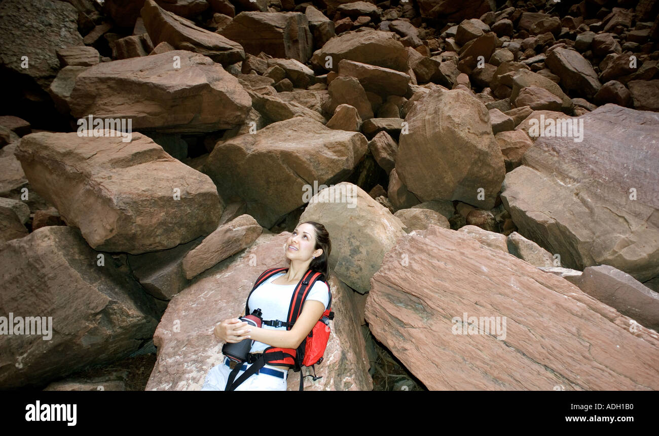 Hiker basking in sunshine - Stock Image