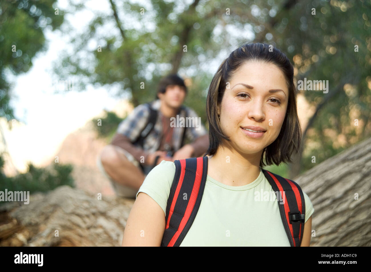 Portrait of a female backpacker - Stock Image