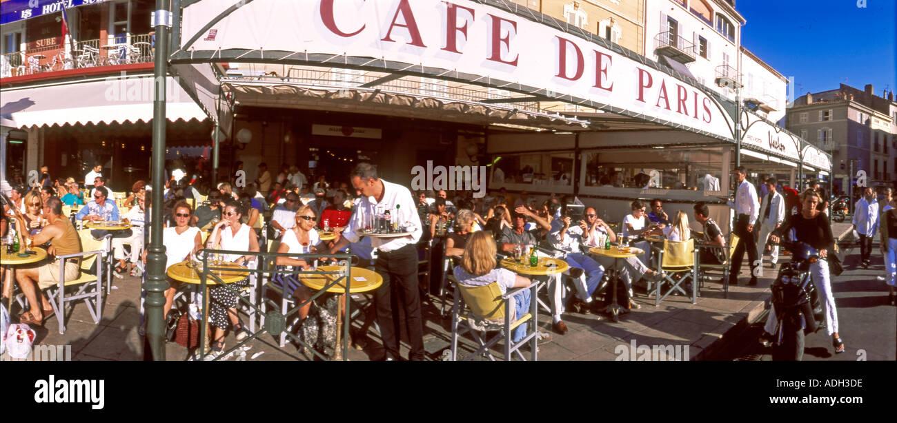 france St Tropez Cafe de Paris terasse people harbour view - Stock Image