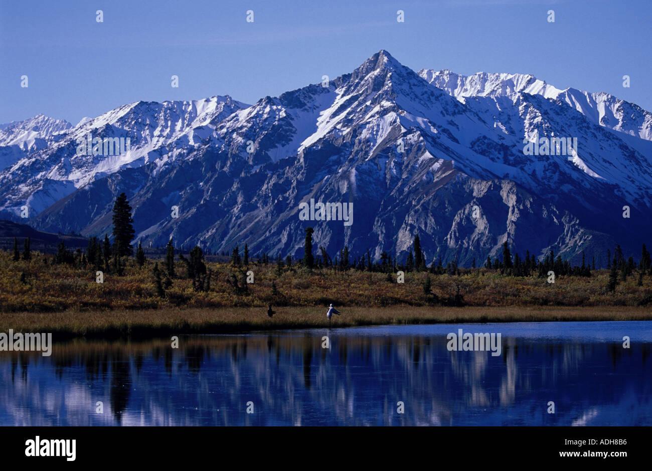 Couple Flyfishing in Lake Chugach Mts SC Alaska Fall Stock Photo
