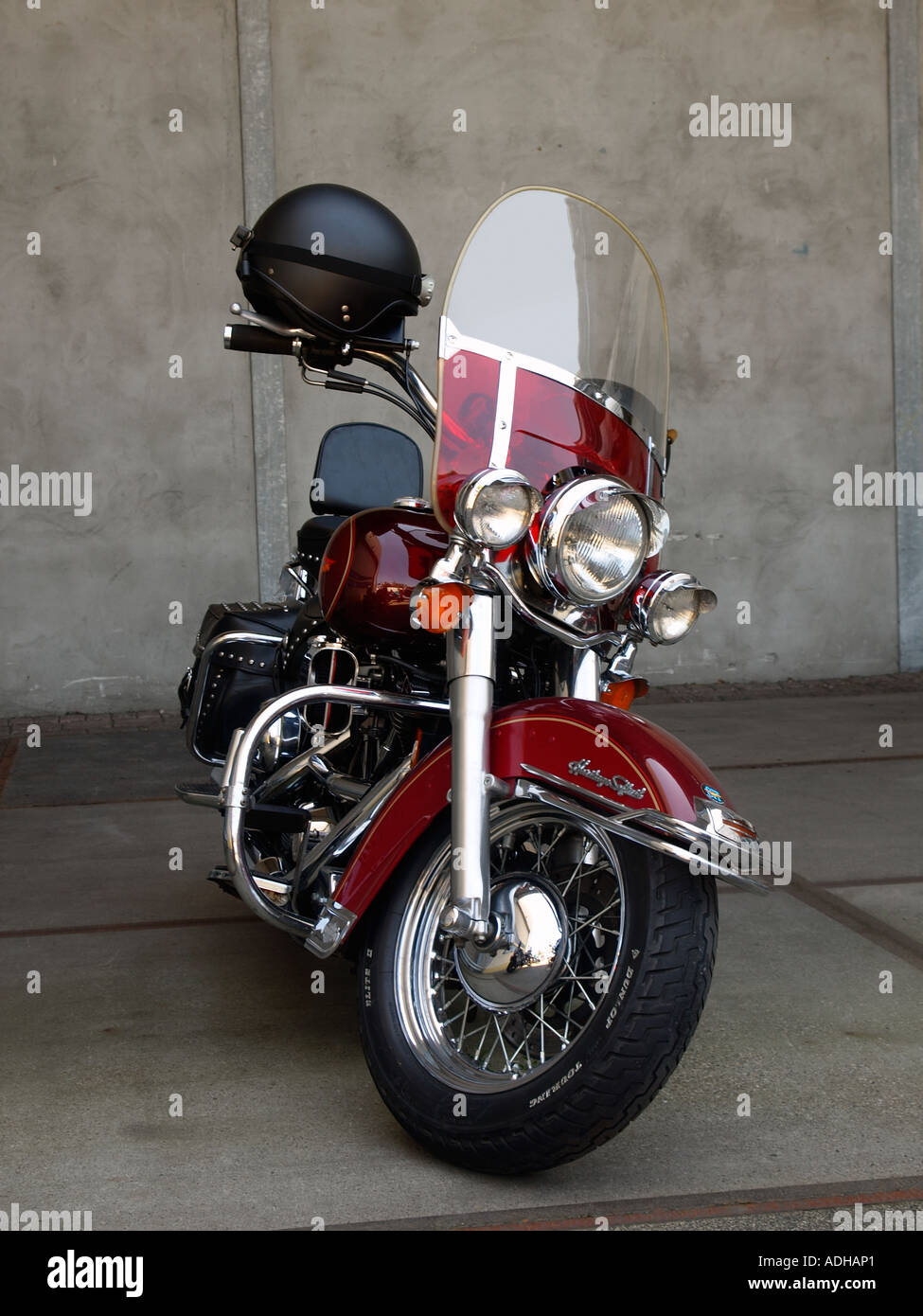 Cherry Red Harley Davidson Heritage Softail Motorcycle Parked Front View With Helmet On The Handlebar Breda Netherlands