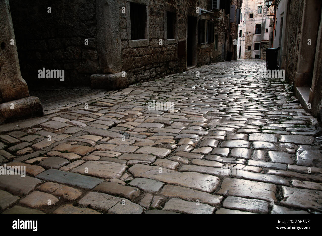 shiny-worn-cobble-stones-in-narrow-stree