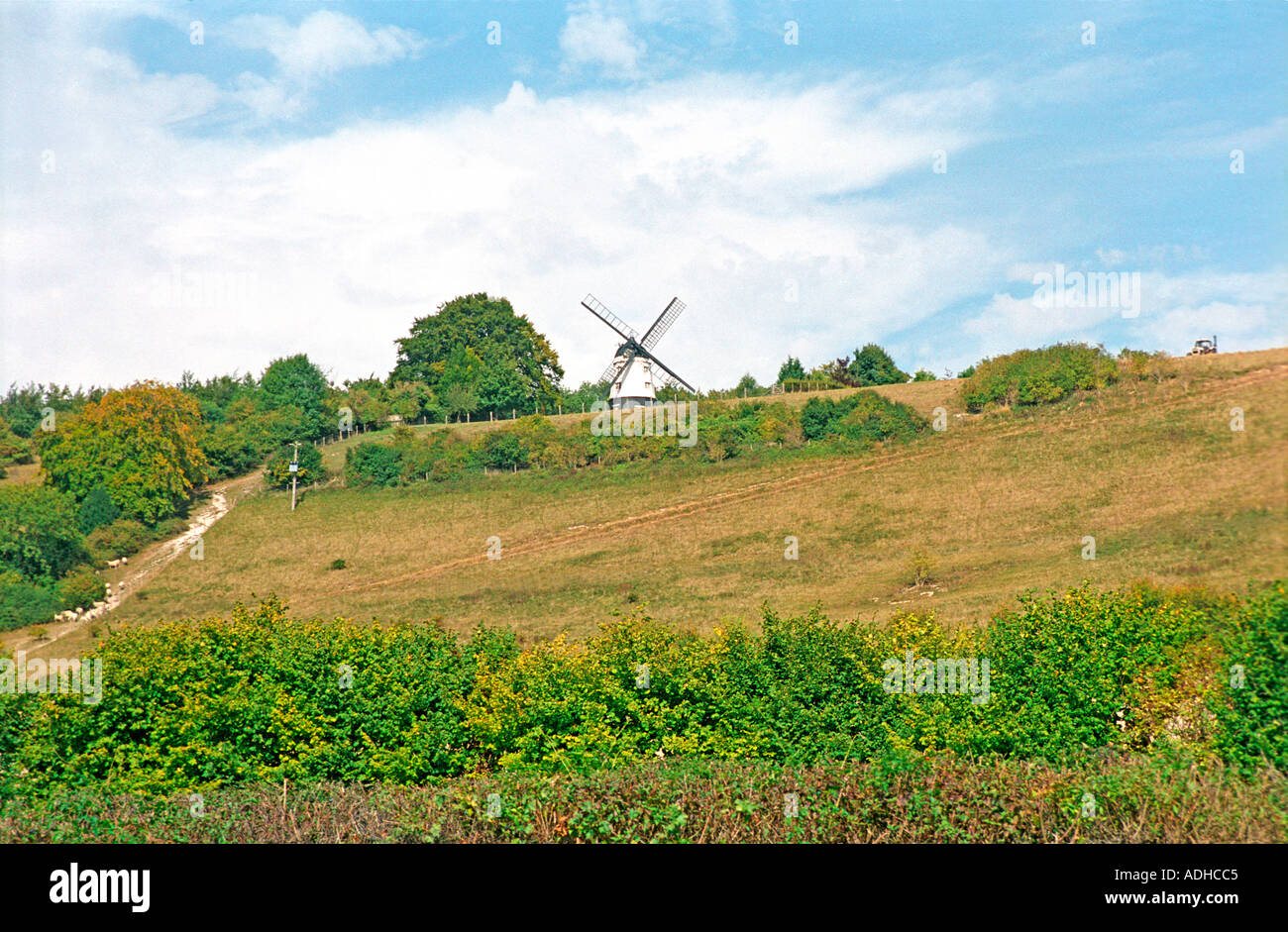Windmill crowns the local countryside scene of many films and TV shows - Stock Image