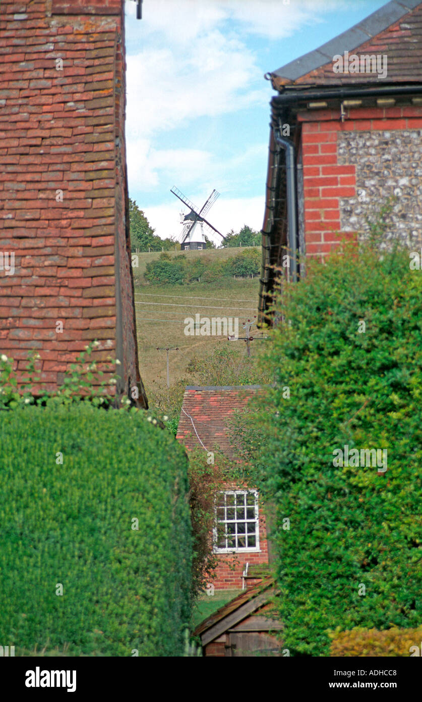 Windmill peeps between two houses scene of many films and TV shows - Stock Image
