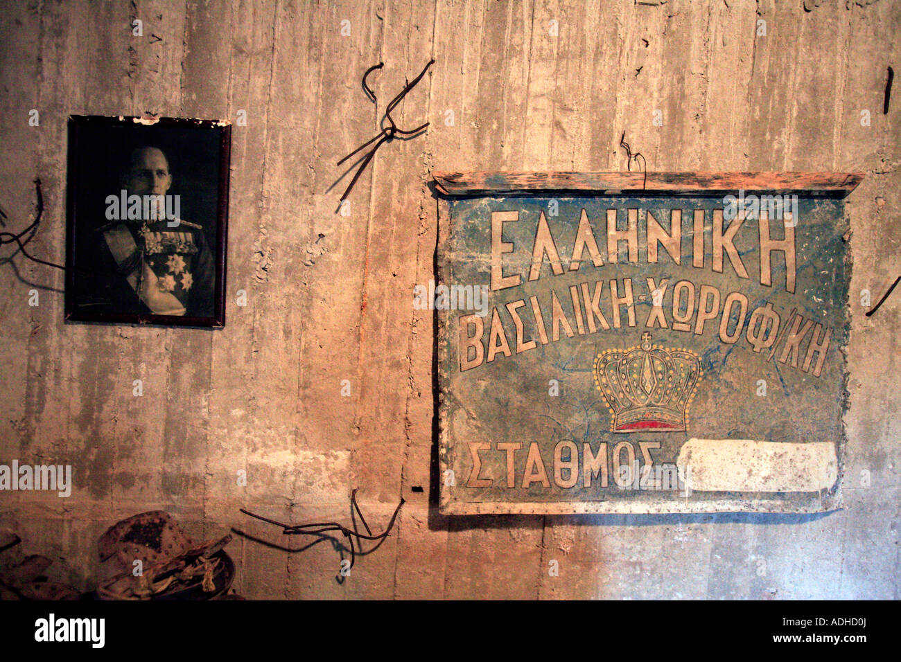 EUROPE GREECE AN OLD FASHIONED SIGN FOR THE GREEK ROYAL FAMILY AND A BLACK AND WHITE PICTURE OF THE GREEK KING - Stock Image