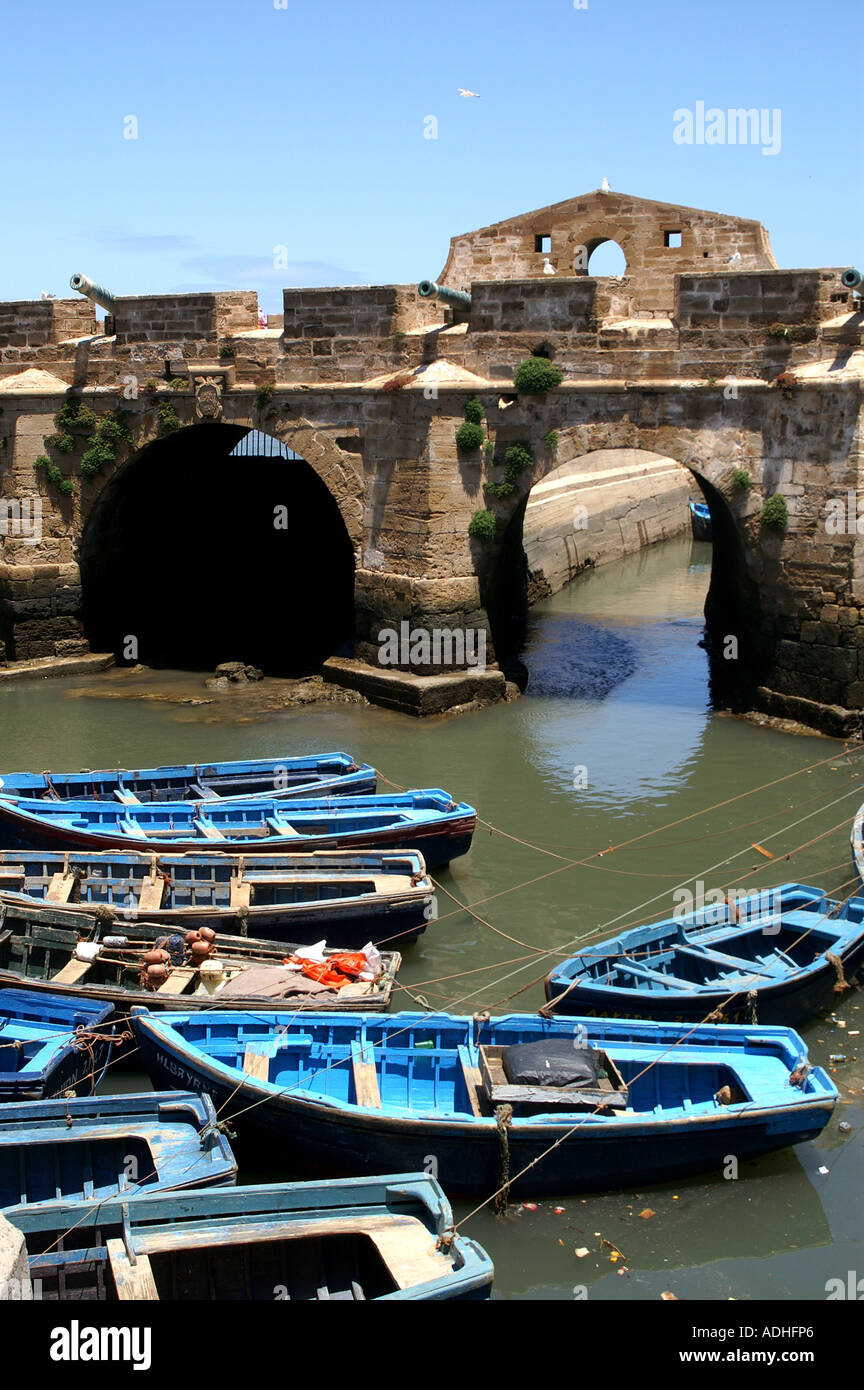 Ramparts and Fishing boats and craft. Harbour of Essaouira Morocco - Stock Image