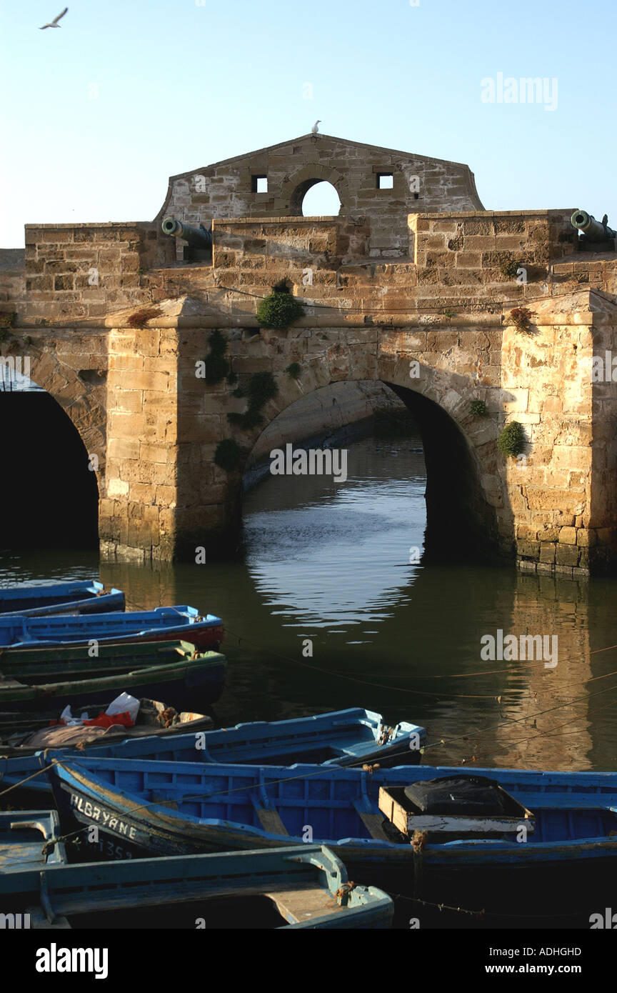 Fishing boats and craft walls ramparts harbour Essaouira Morocco - Stock Image