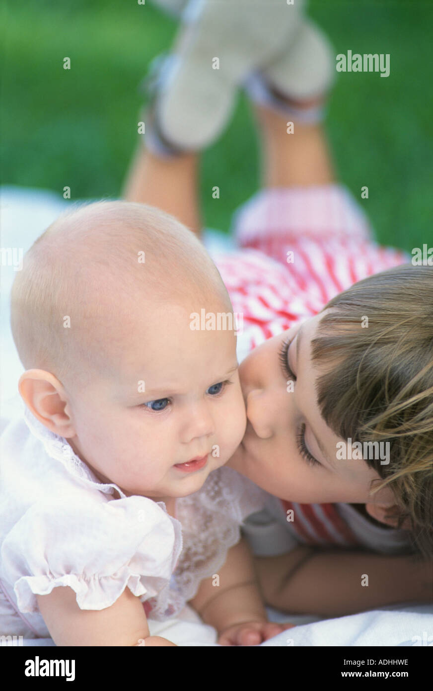 Two Loving Sisters Kiss Stock Photos  Two Loving Sisters Kiss Stock Images - Alamy-6967