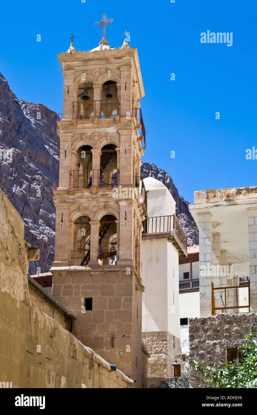 Christian bell tower neighboring Moslem minaret in Monastery of St Catherine with Mount Sinai in background Egypt - Stock Image
