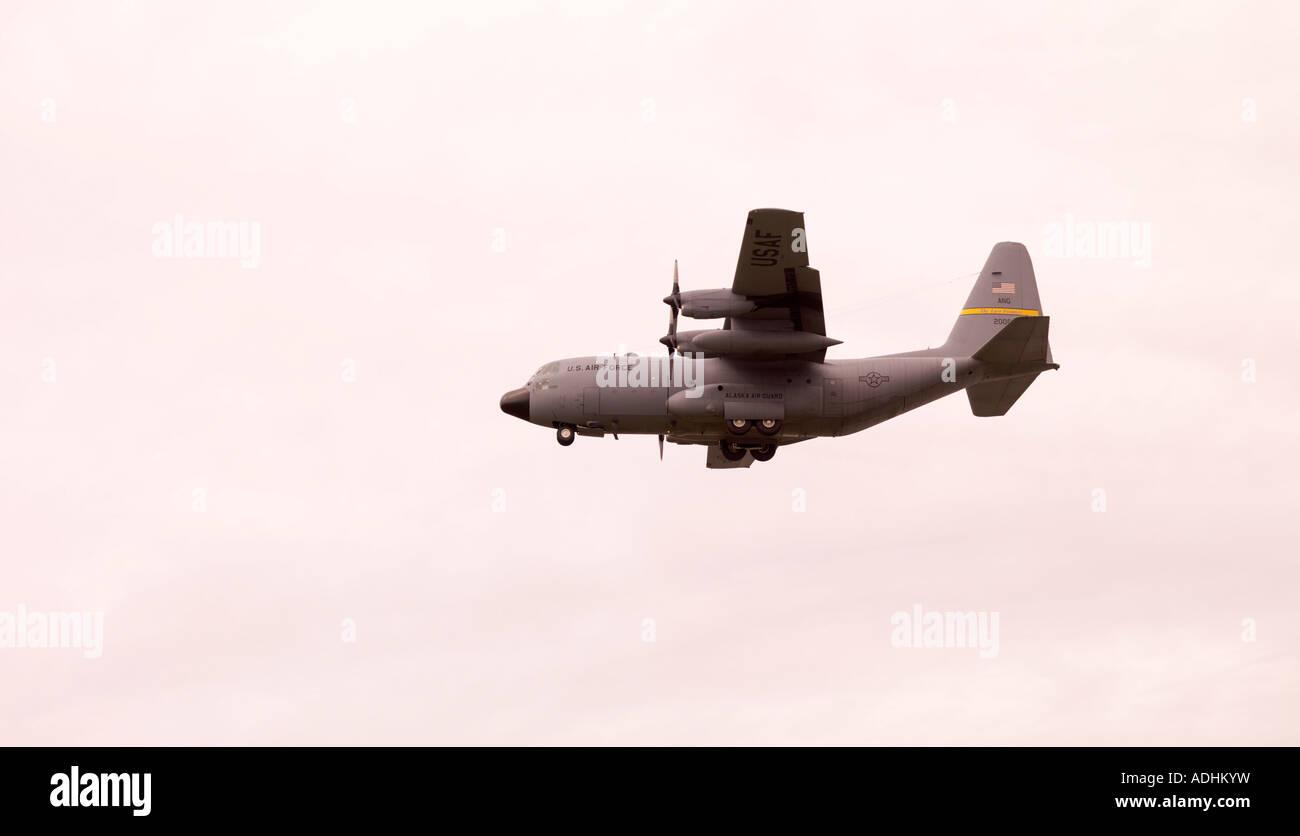 The U S Air Force Alaska Air Guard C 130 coming in for landing - Stock Image