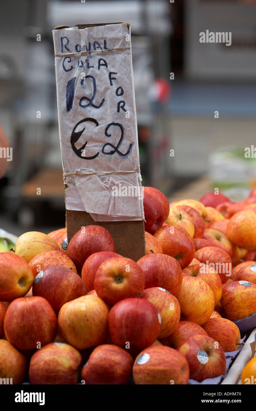 royal gala apples with sign 12 twelve for 2 two euro prices at outdoor market dublin - Stock Image