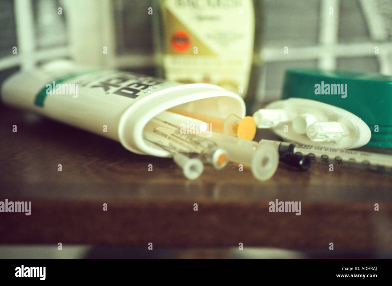 Syringes and drugs hidden inside deodorant bottle. Confiscated from inmate. Nebraska State Penitentiary, USA. - Stock Image