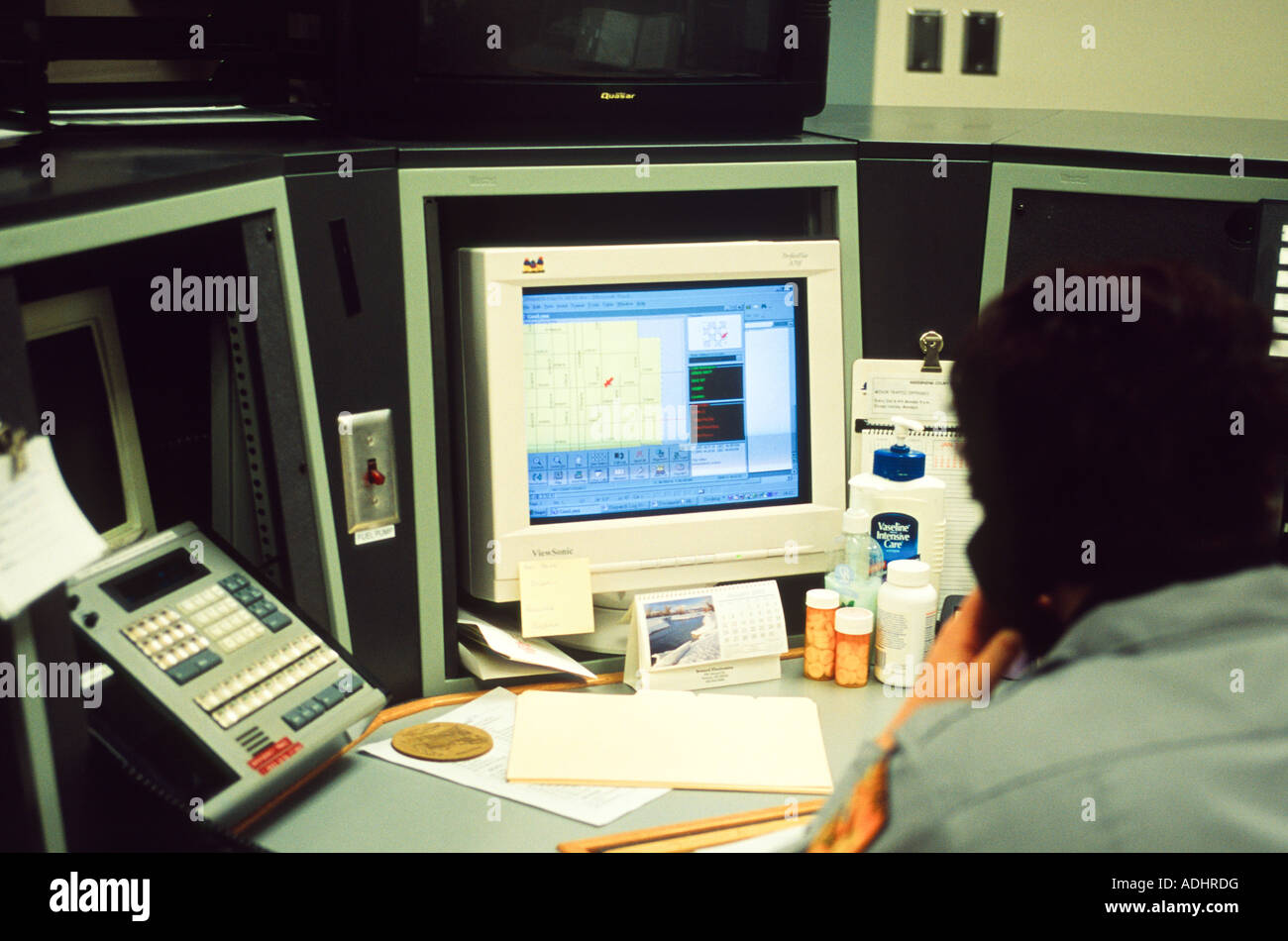 Dispatch at rural Sheriff's Office in Nebraska, USA. Dispatcher taking a 911 call. - Stock Image