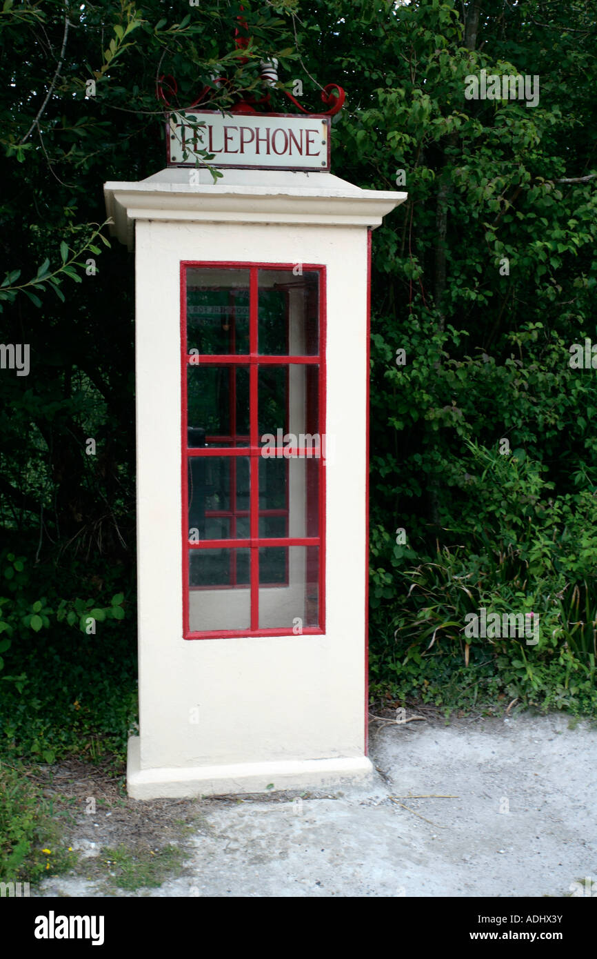 Old cream painted telephone kiosk on exhibit at Amberley Working Museum, Sussex, UK - Stock Image