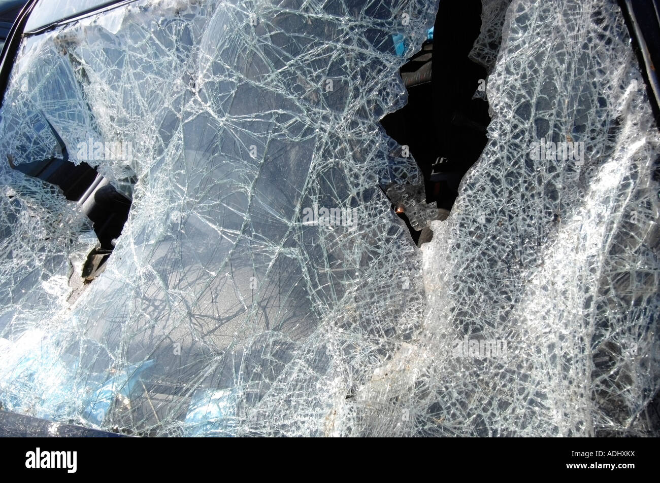 The shattered windscreen of a car wrecked in a road accident - Stock Image