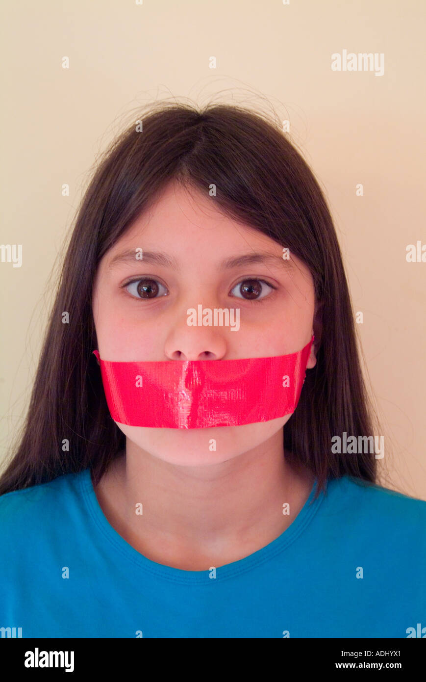 Young Girl With Tape Over Her Mouth Stock Image