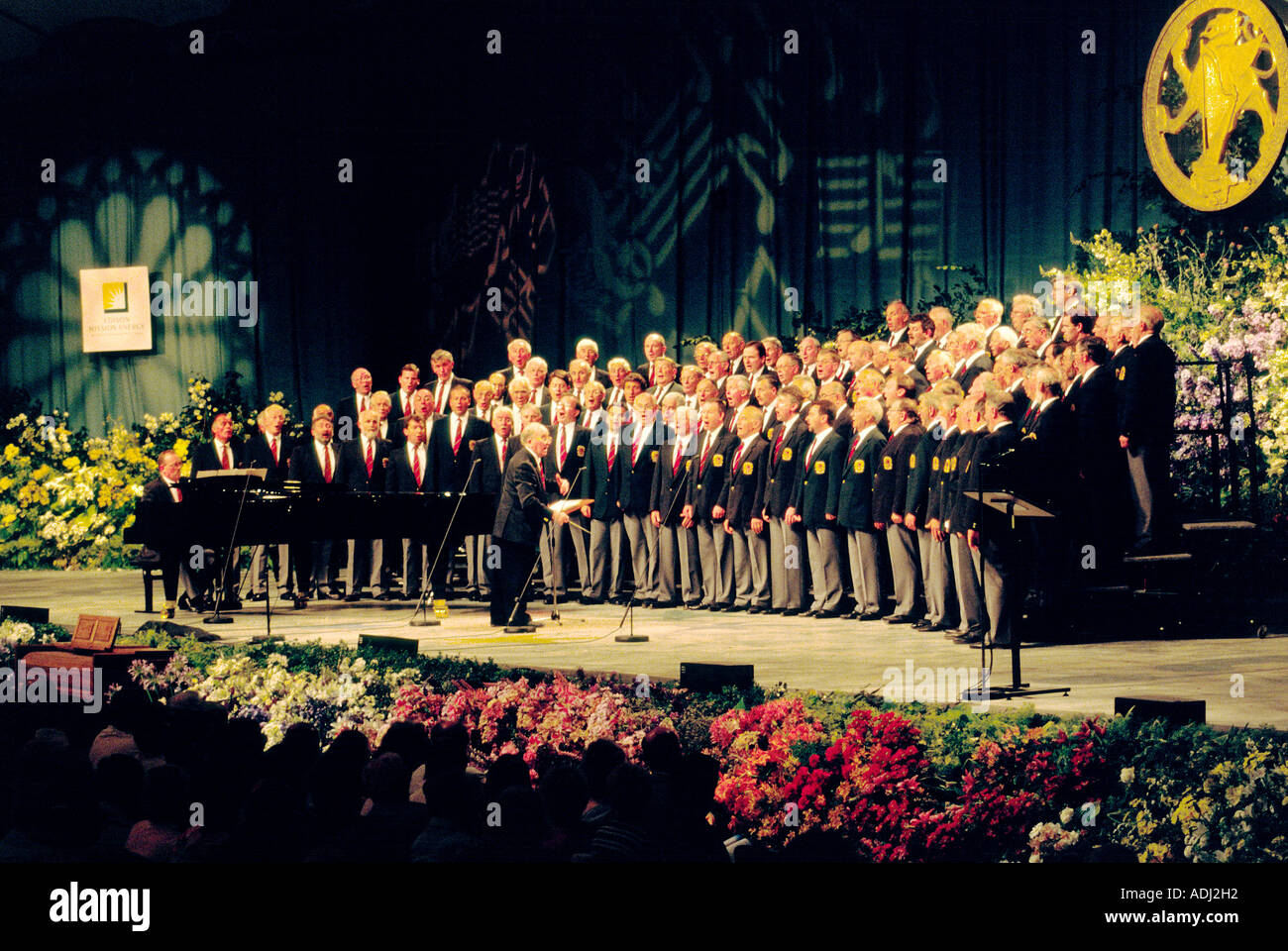 Welsh male voice choir singing on stage at the annual Llangollen International Eisteddfod, Clwyd, Wales, UK - Stock Image