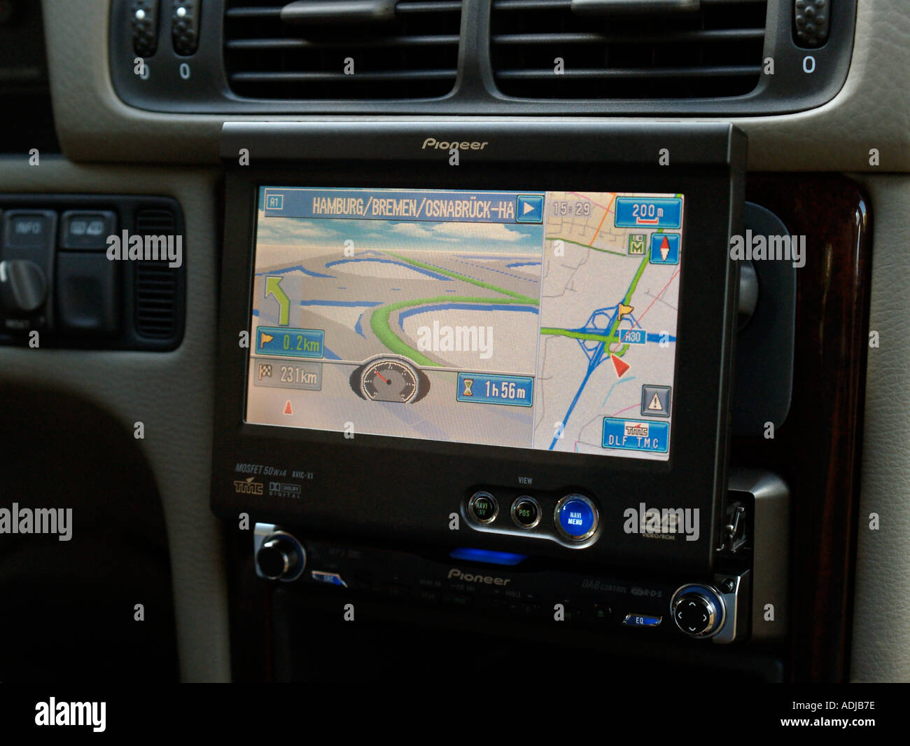 Pioneer retractable DVD in car GPS navigation system showing a highway near Hamburg Germany on screen - Stock Image