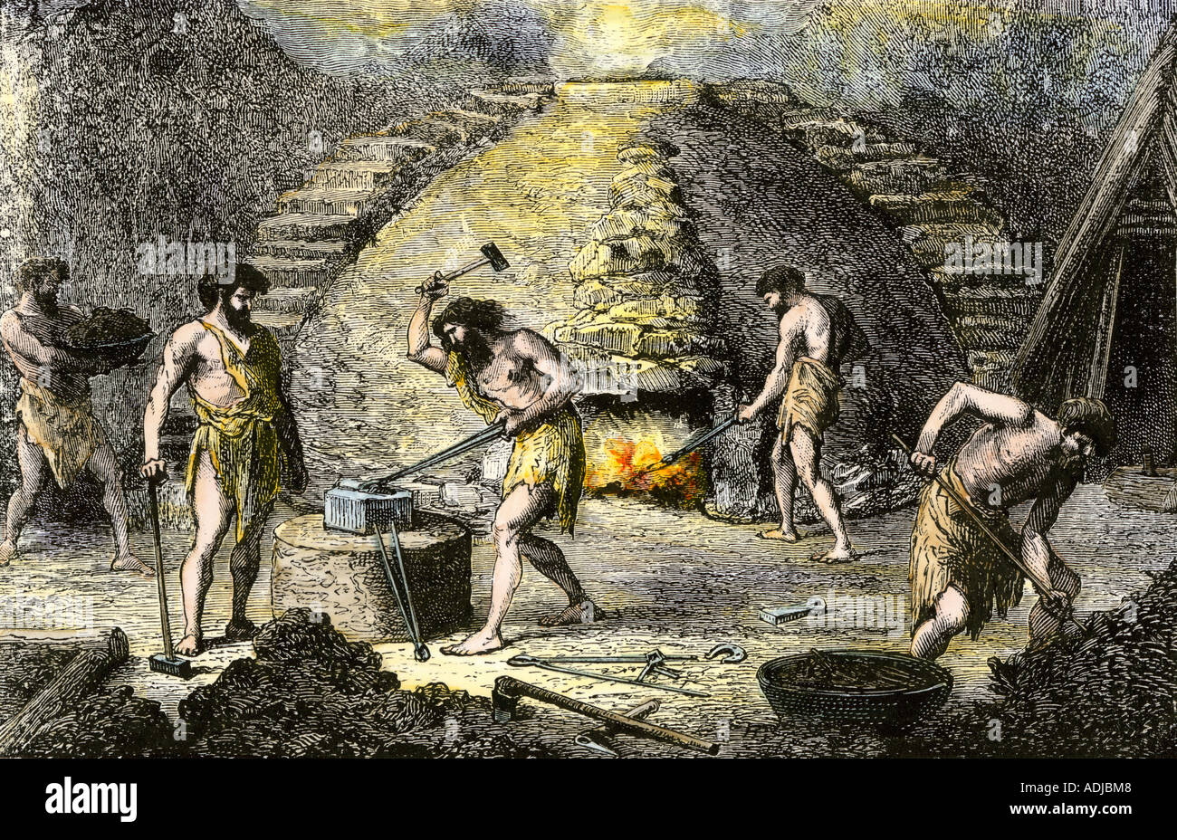 Prehistoric people learning how to work iron. Hand-colored woodcut - Stock Image