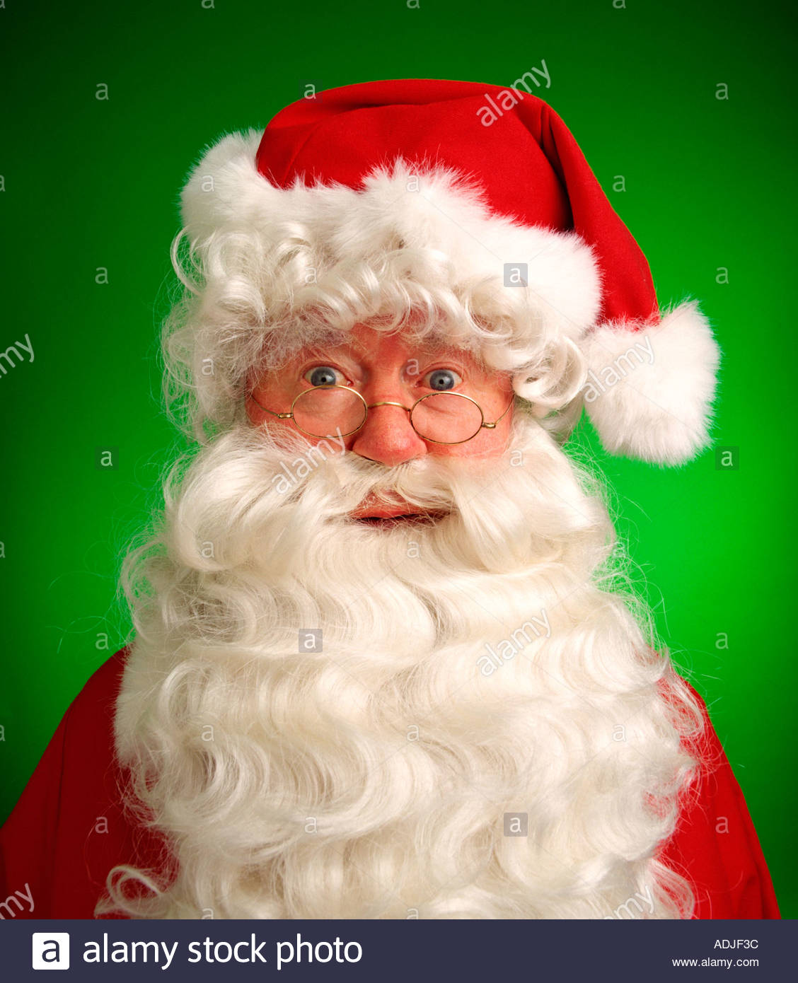 Smiling Santa Claus portrait with green background - Stock Image