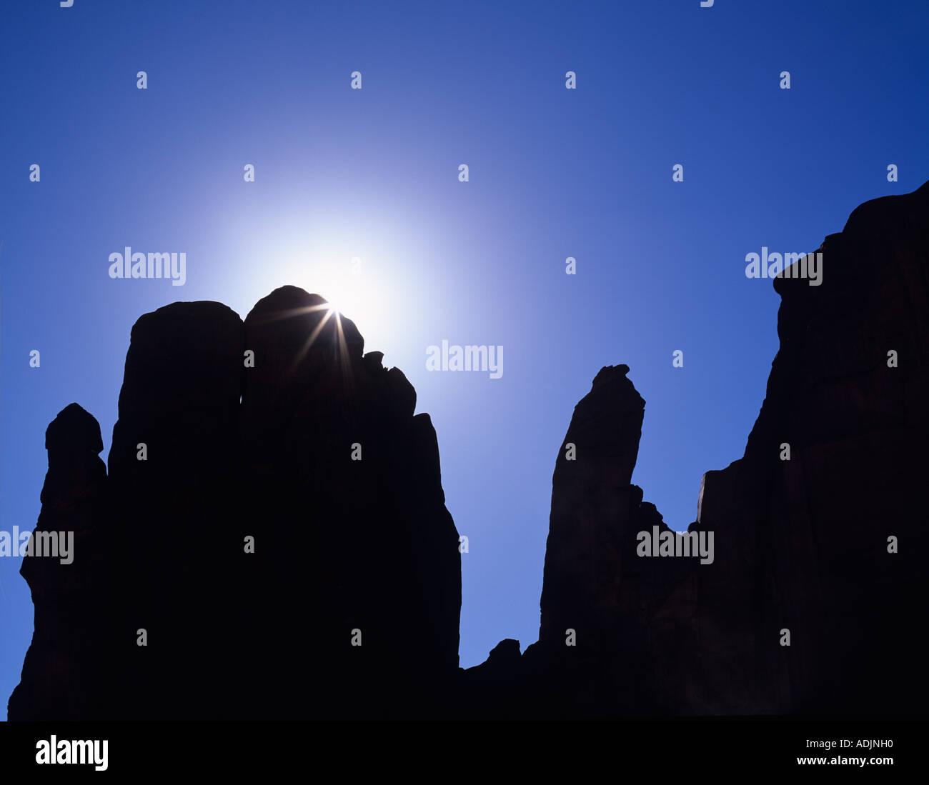 Sunburst over rock formation Monument Valley AZ - Stock Image