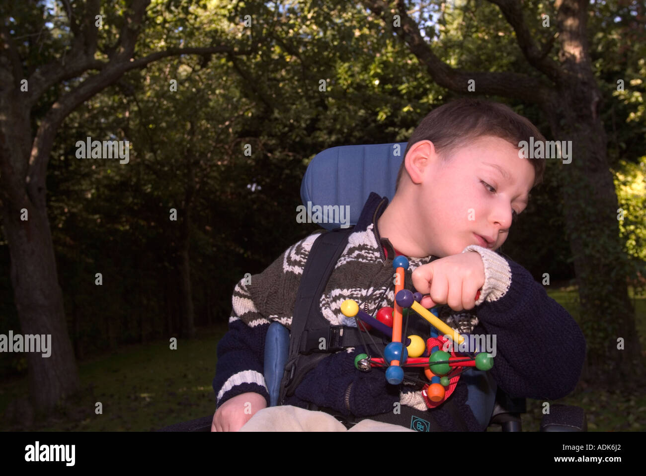 Young disabled child in wheelchair London UK - Stock Image