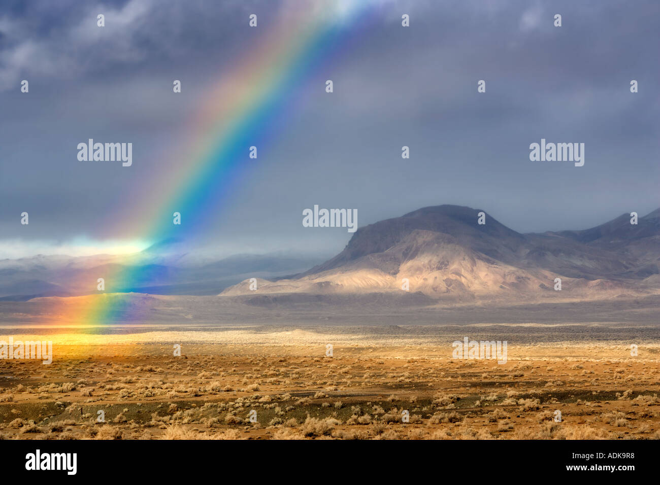 Rainbow with mountains Black Rock Desert National Conservation Area Nevada - Stock Image