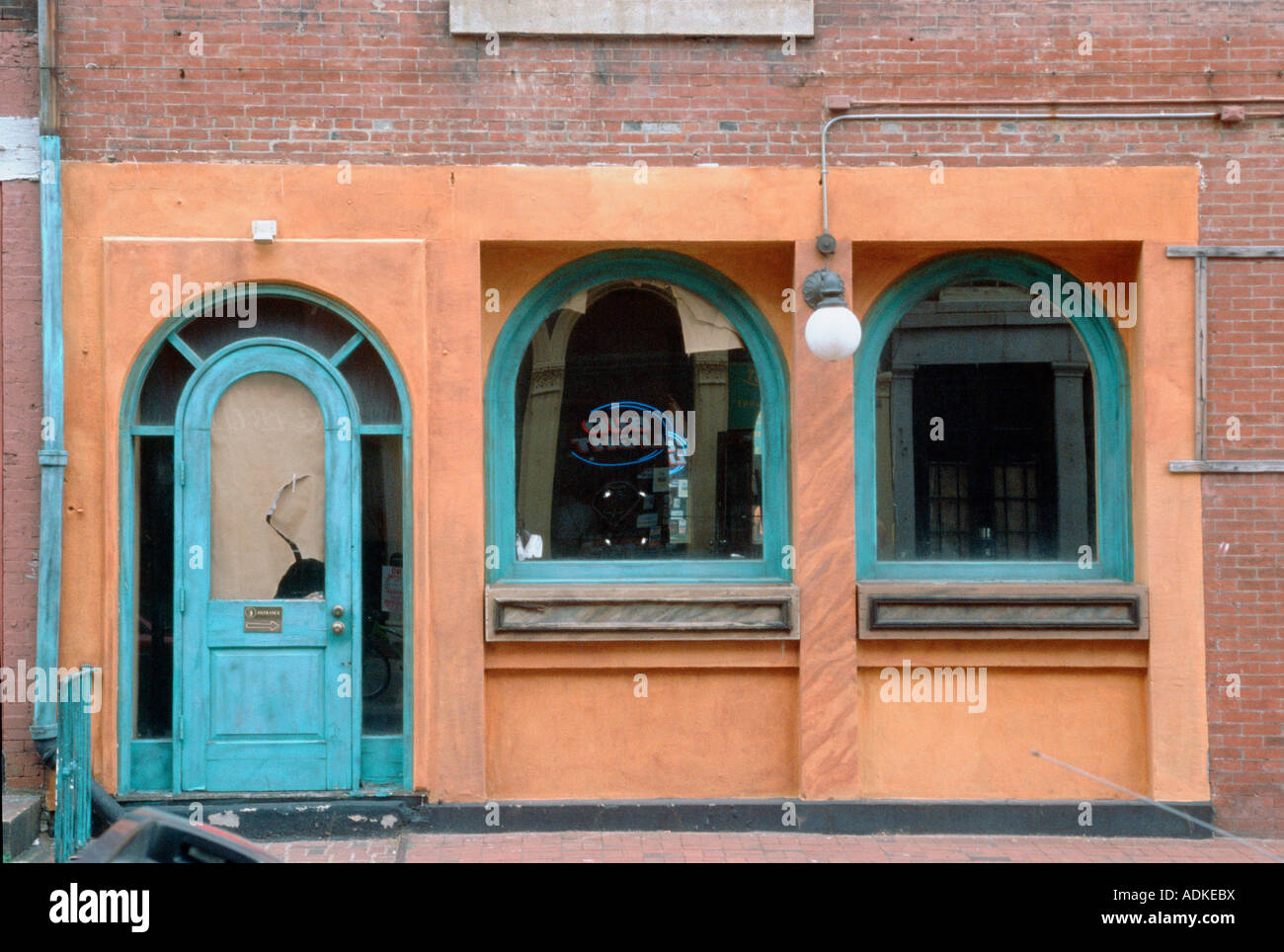 Arched Broken Doors And Window On Brick Building And Sidewalk In The City  Blue Frames And