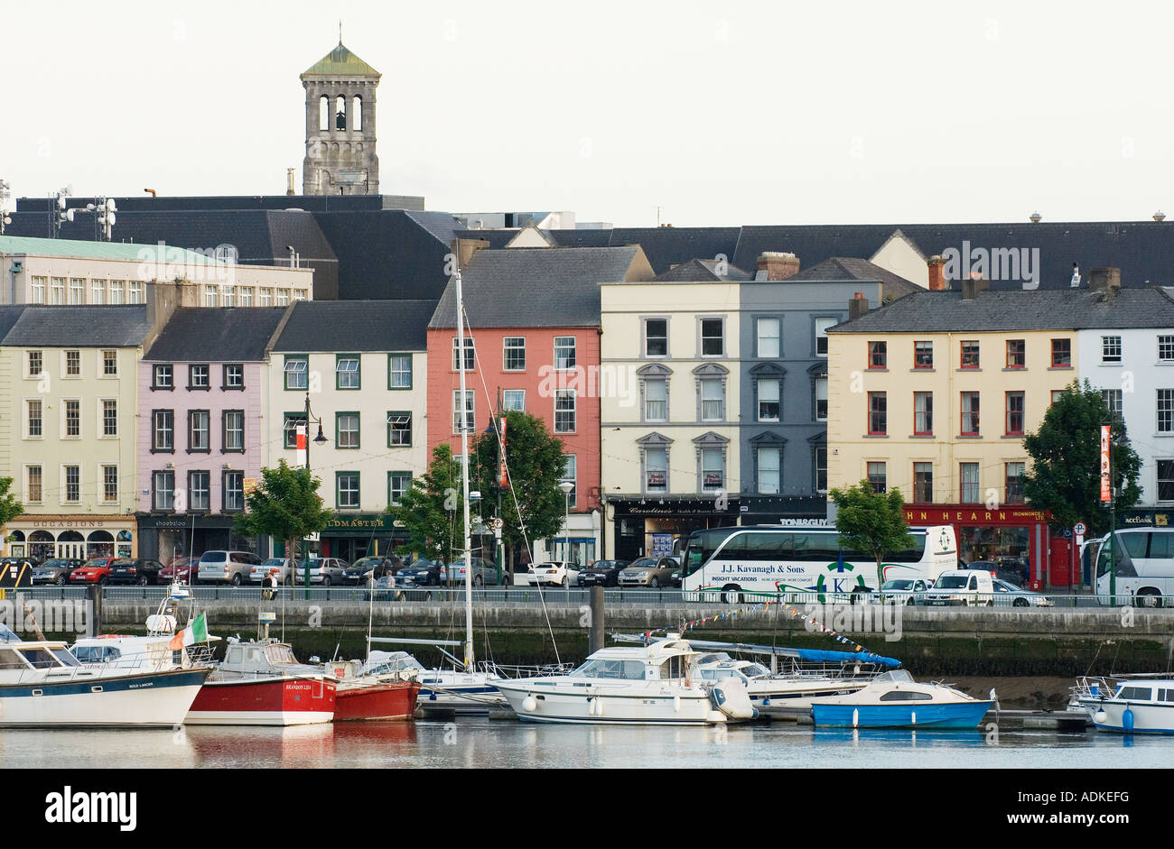 Old quayside buildings line the south bank of the River Suir in the city of Waterford, County Waterford, Ireland. - Stock Image