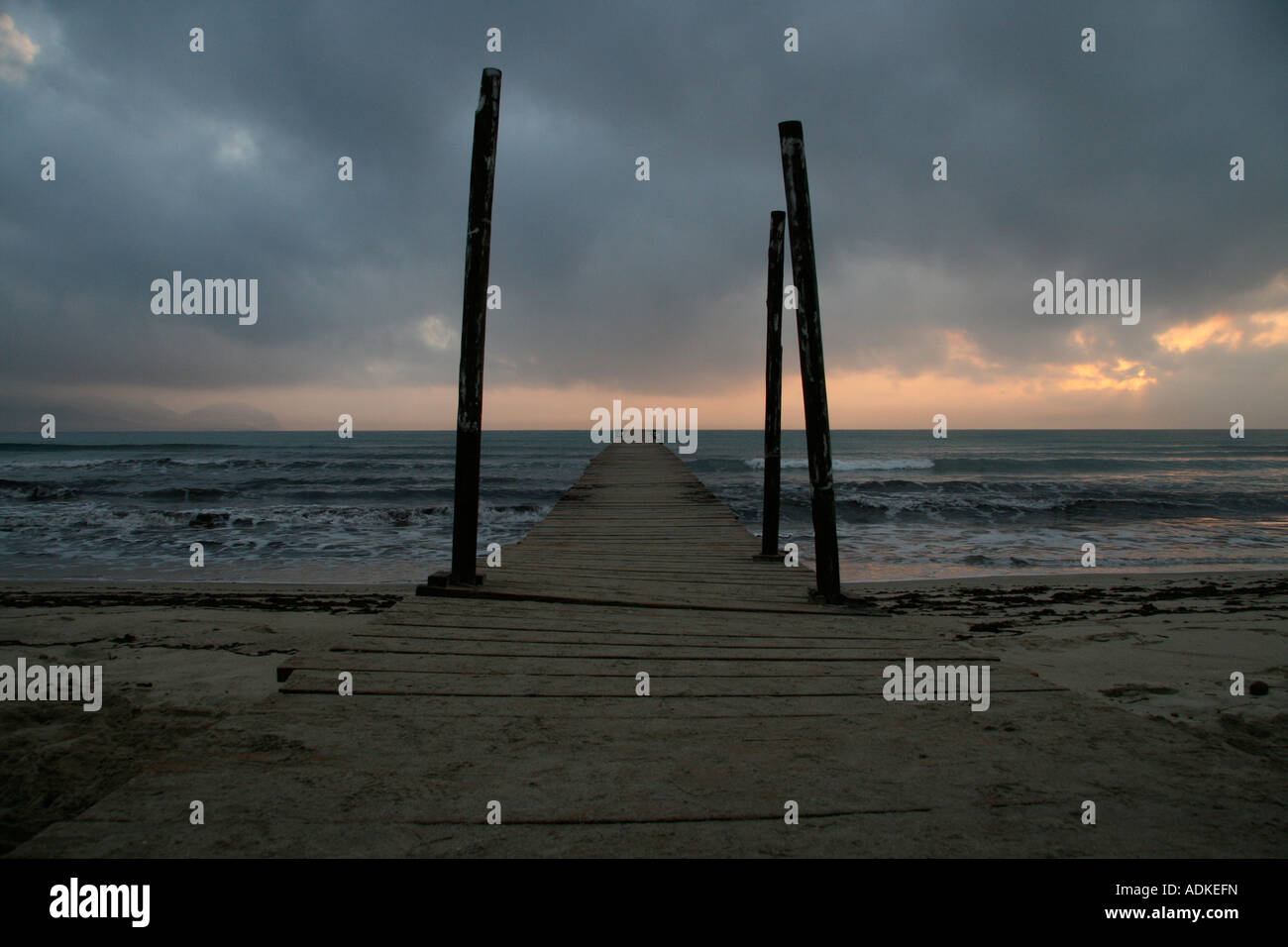 Pier in Alcudia, Mallorca on cloudy day - Stock Image