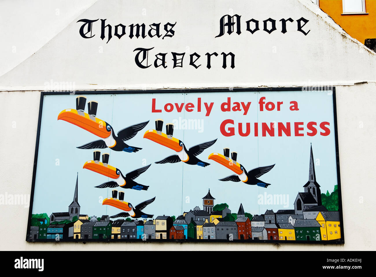 Poet and balladeer Thomas Moore is regarded as Ireland's national bard. Wexford city skyline pub wall Guinness sign, - Stock Image