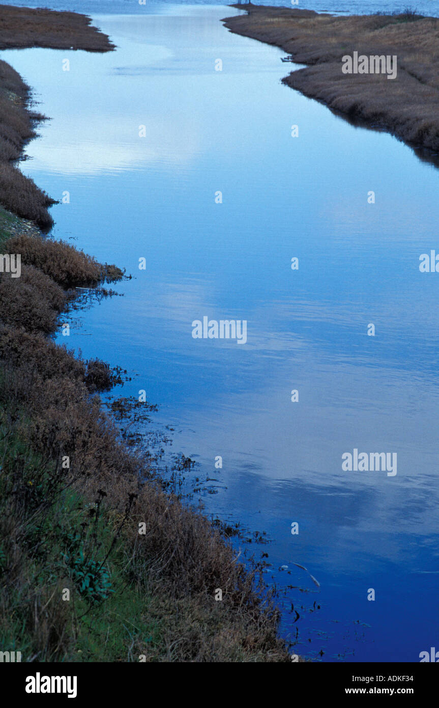 River Flowing Into Large Body Of Water - Stock Image