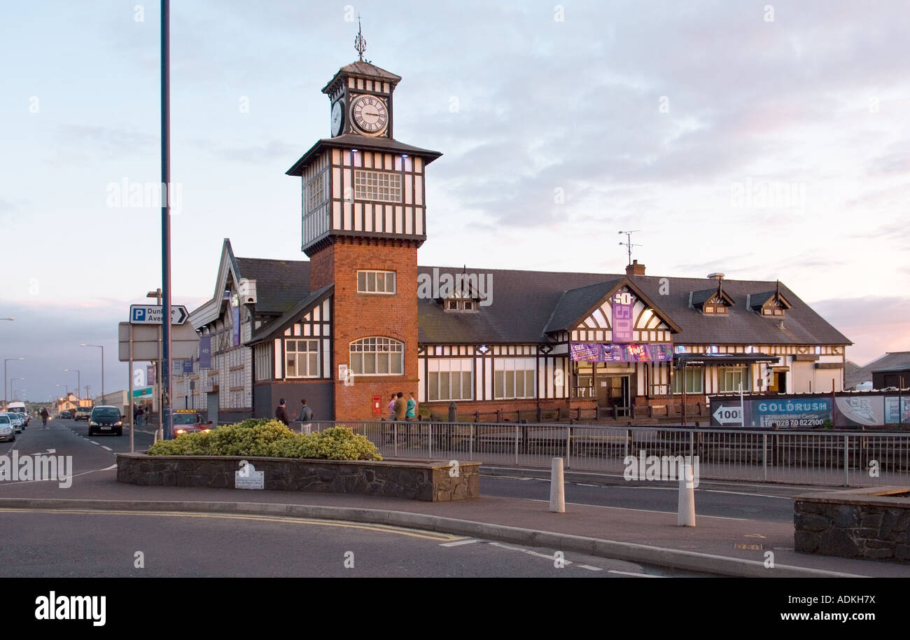 The mock Tudor style Victorian railway train station in the holiday seaside resort of Portrush opened in 1855. - Stock Image