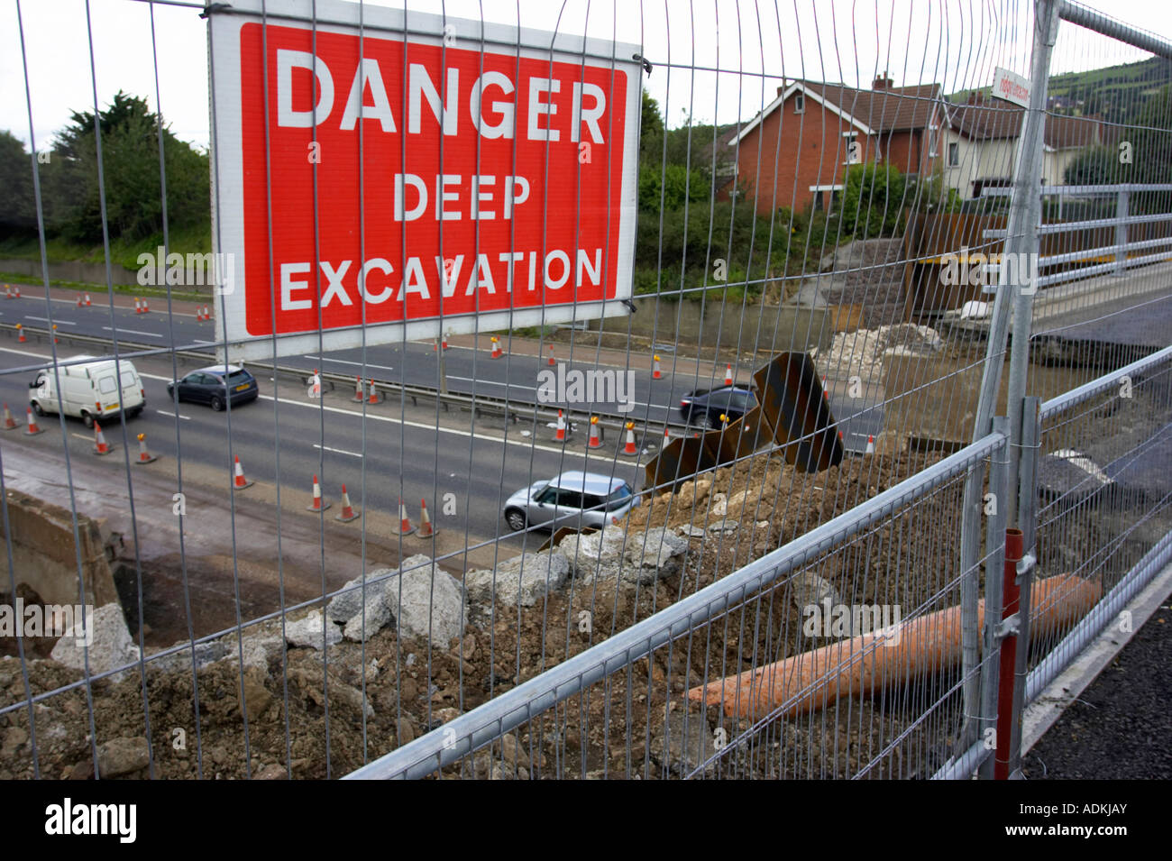 Danger Deep Excavation Sign Attached To Metal Fence Surrounding Stock Photo Alamy