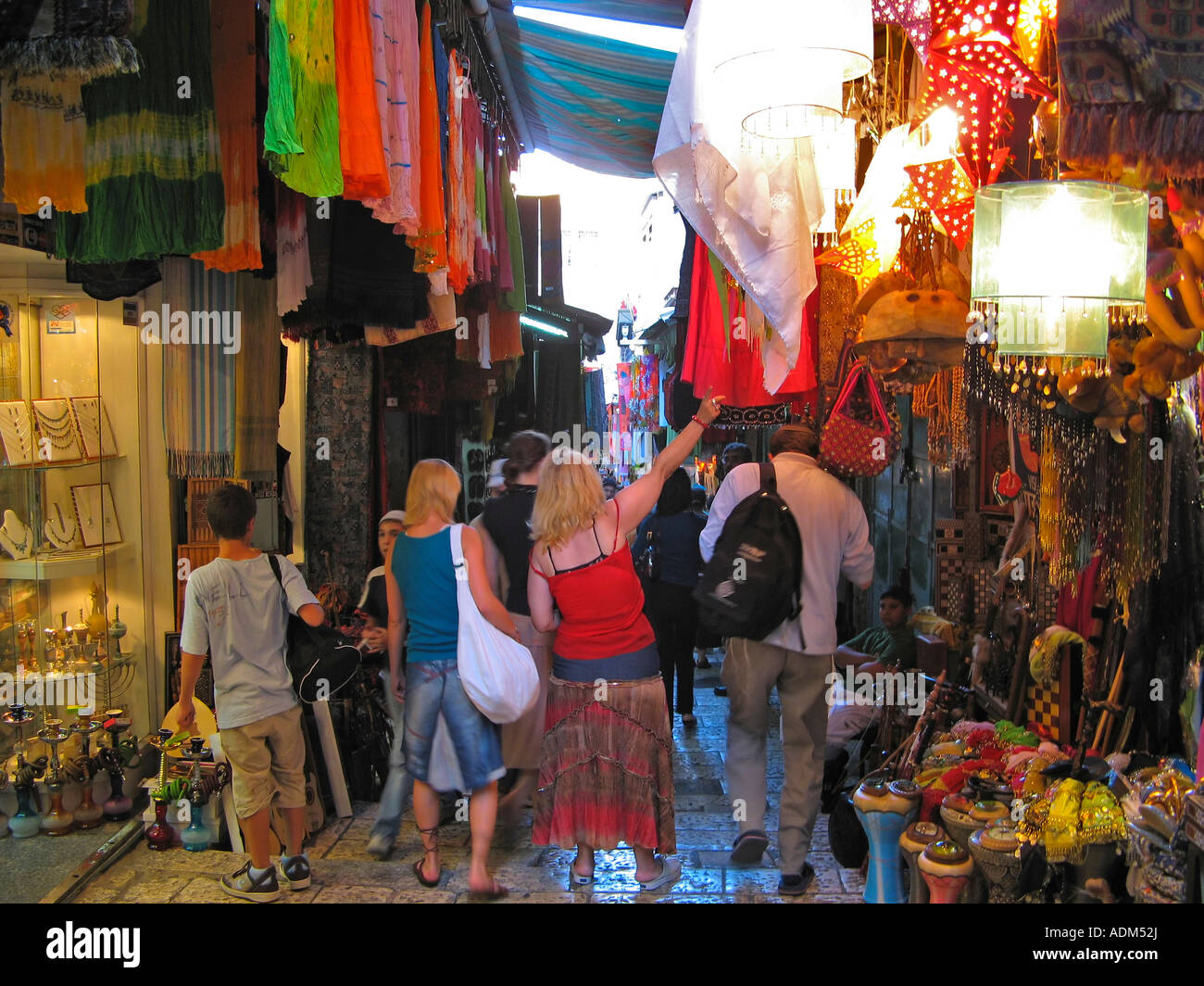 shoppers in the bazaar of the old city of Jerusalem, Israel, on the way to the Western Wall (the Wailing Wall) - Stock Image