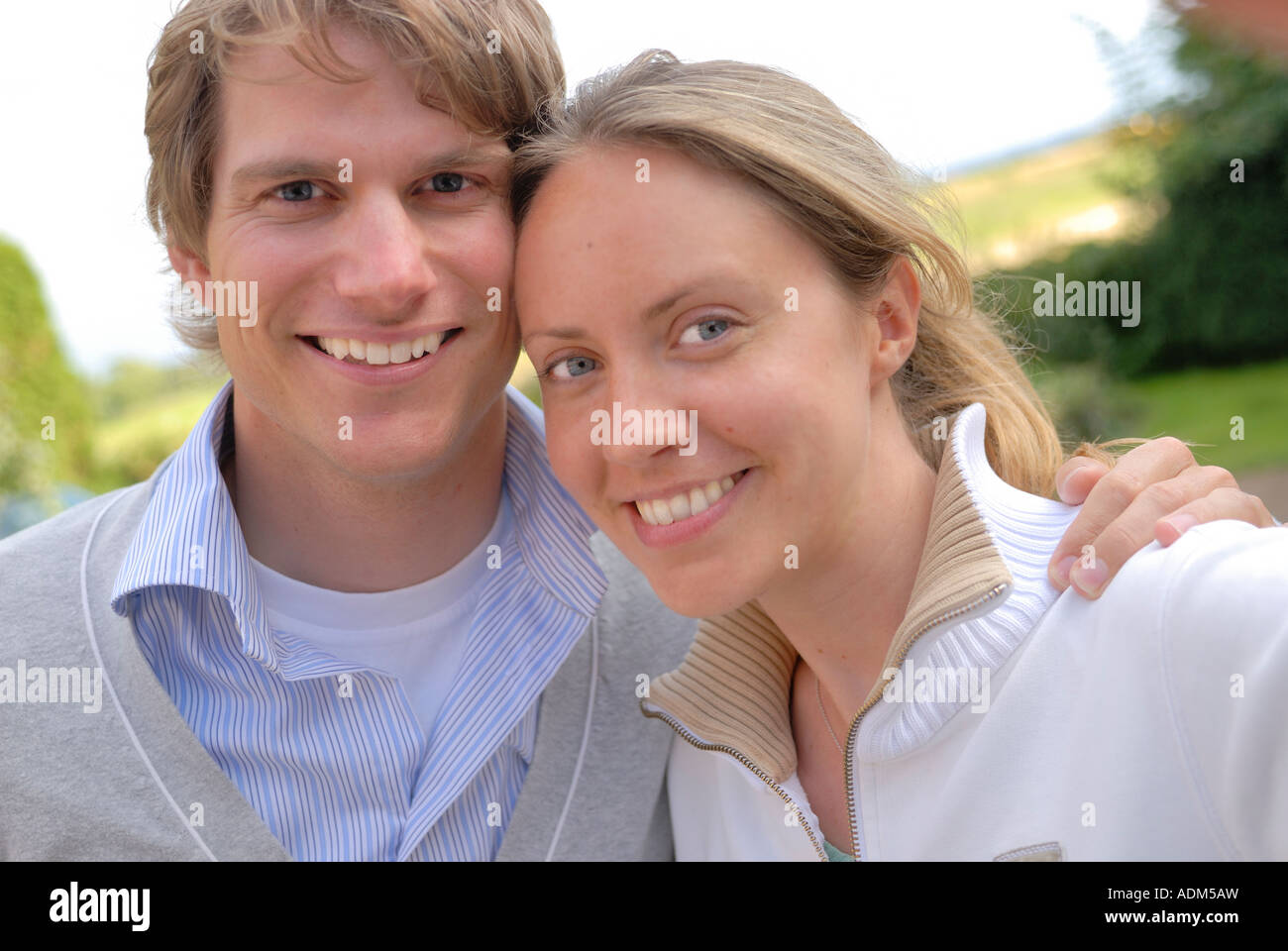 Young couple taking self portrait photograph - Stock Image