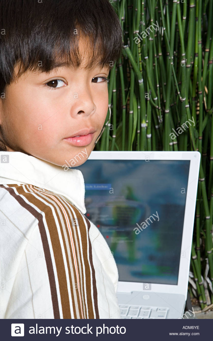 Boy with a laptop - Stock Image