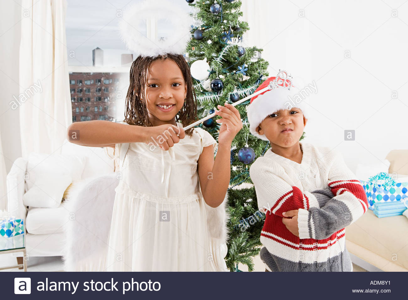 Mischievous brother and sister in costumes - Stock Image