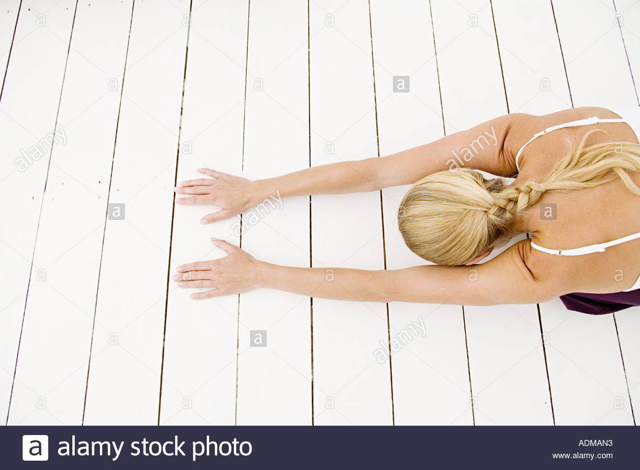 A woman in child pose - Stock Image