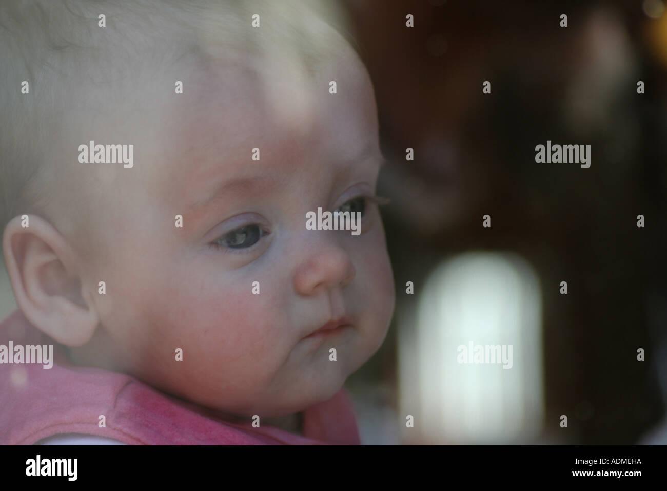 Twelve week old baby girl, Lucy. Glasgow, Scotland, United Kingdom. - Stock Image