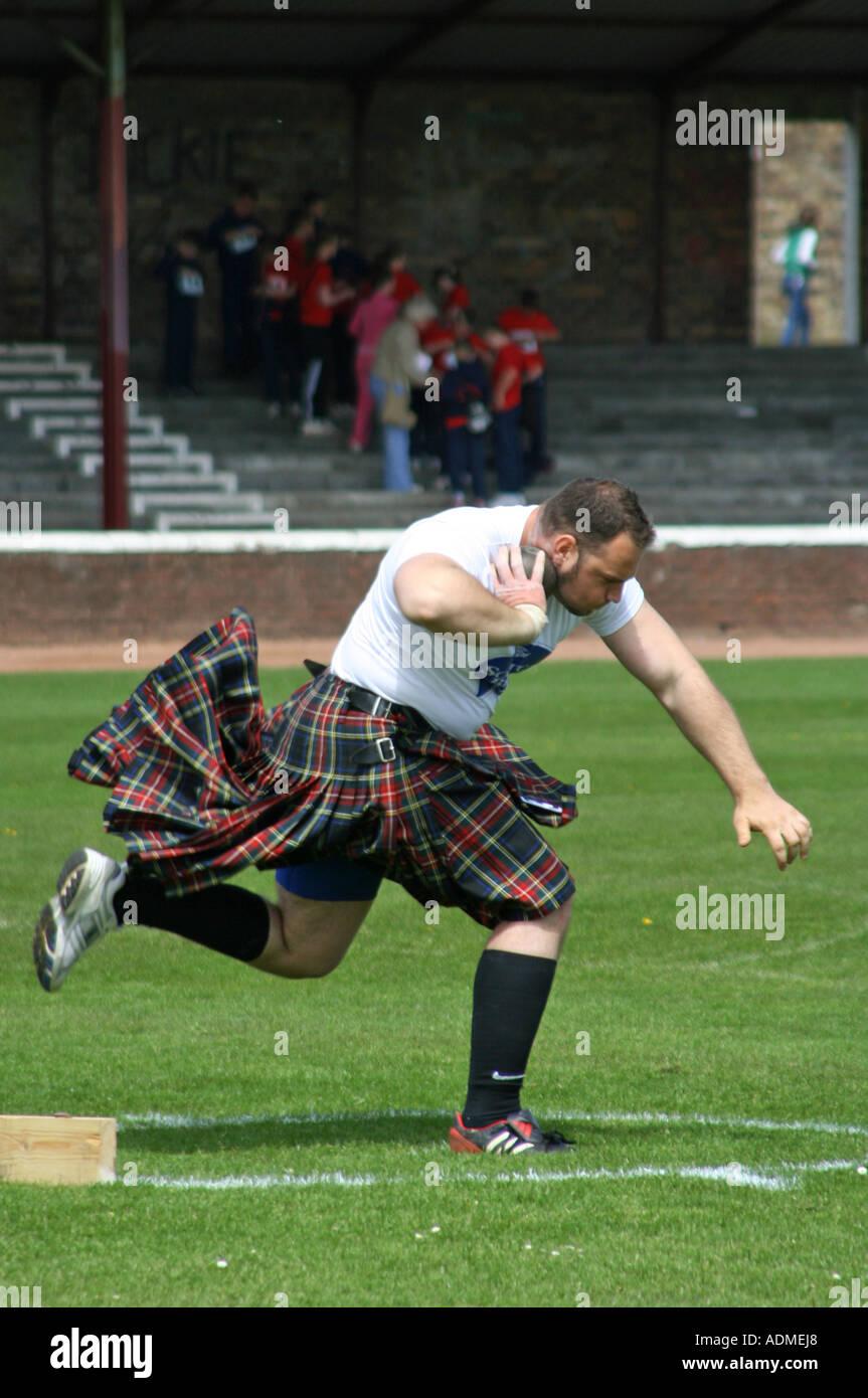 Putting the shot. Shotts Highland Games, Scotland, United Kingdom. 2006. - Stock Image