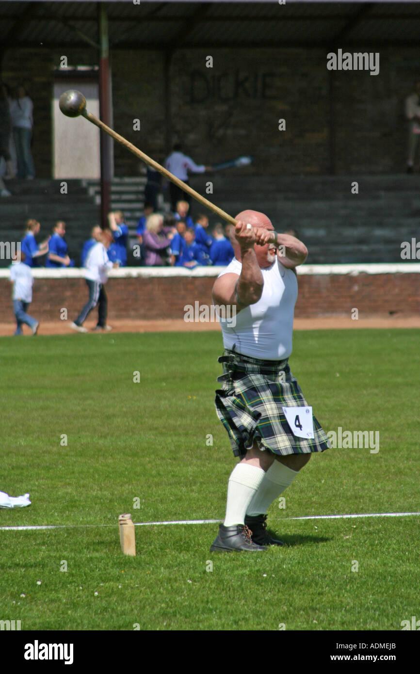 Throwing the hammer. Shotts Highland Games, Scotland, United Kingdom. 2006. - Stock Image