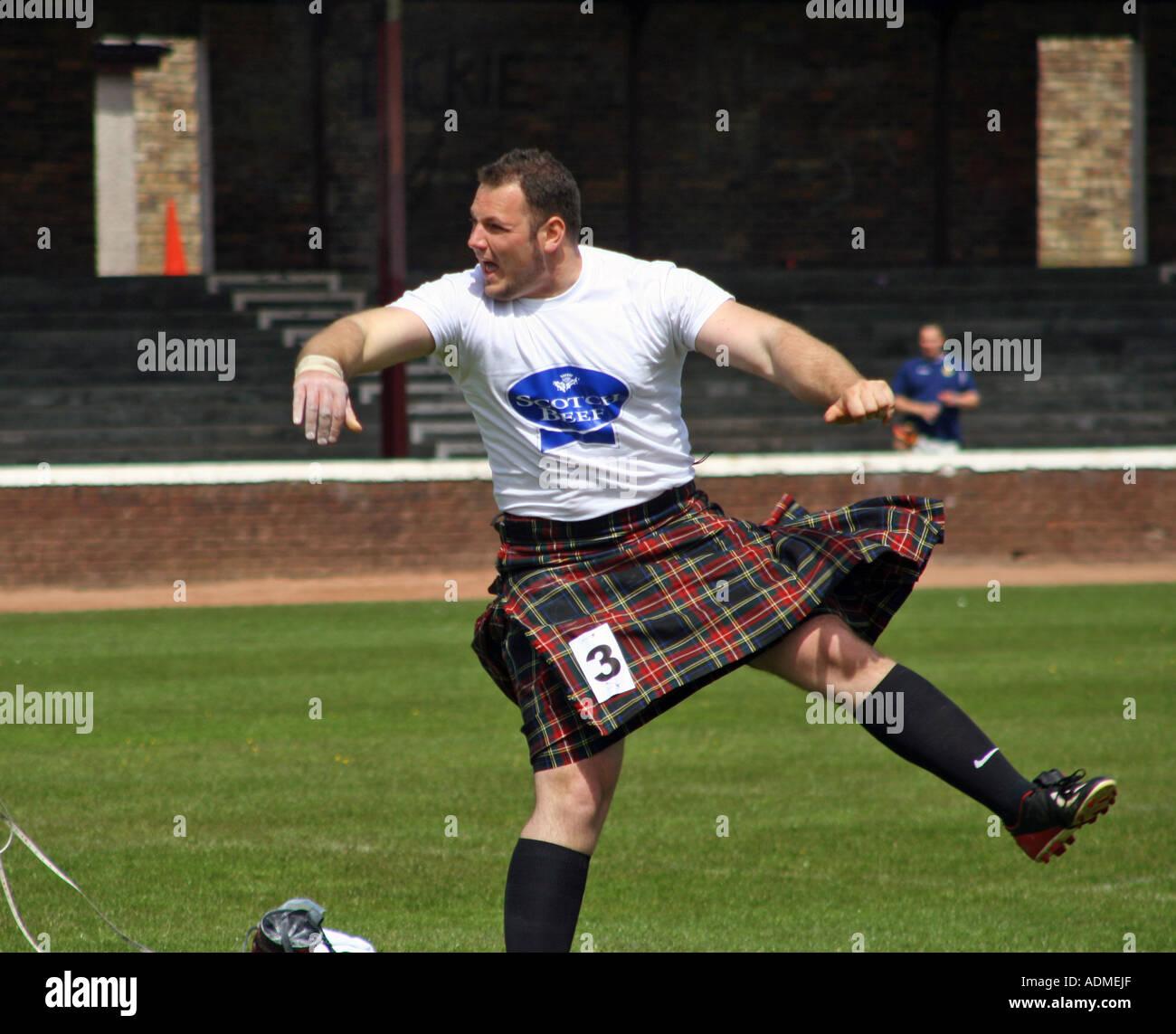 Putting the shot. Shotts Highland Games, Scotland, United Kingdom. June 2006. - Stock Image