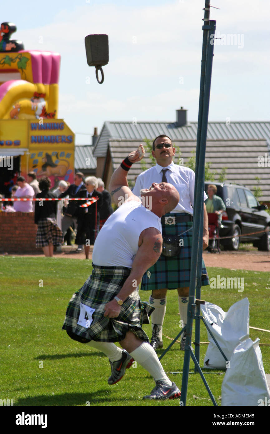 Tossing the 56lb weight over the bar Shotts Highland Games Scotland UK - Stock Image