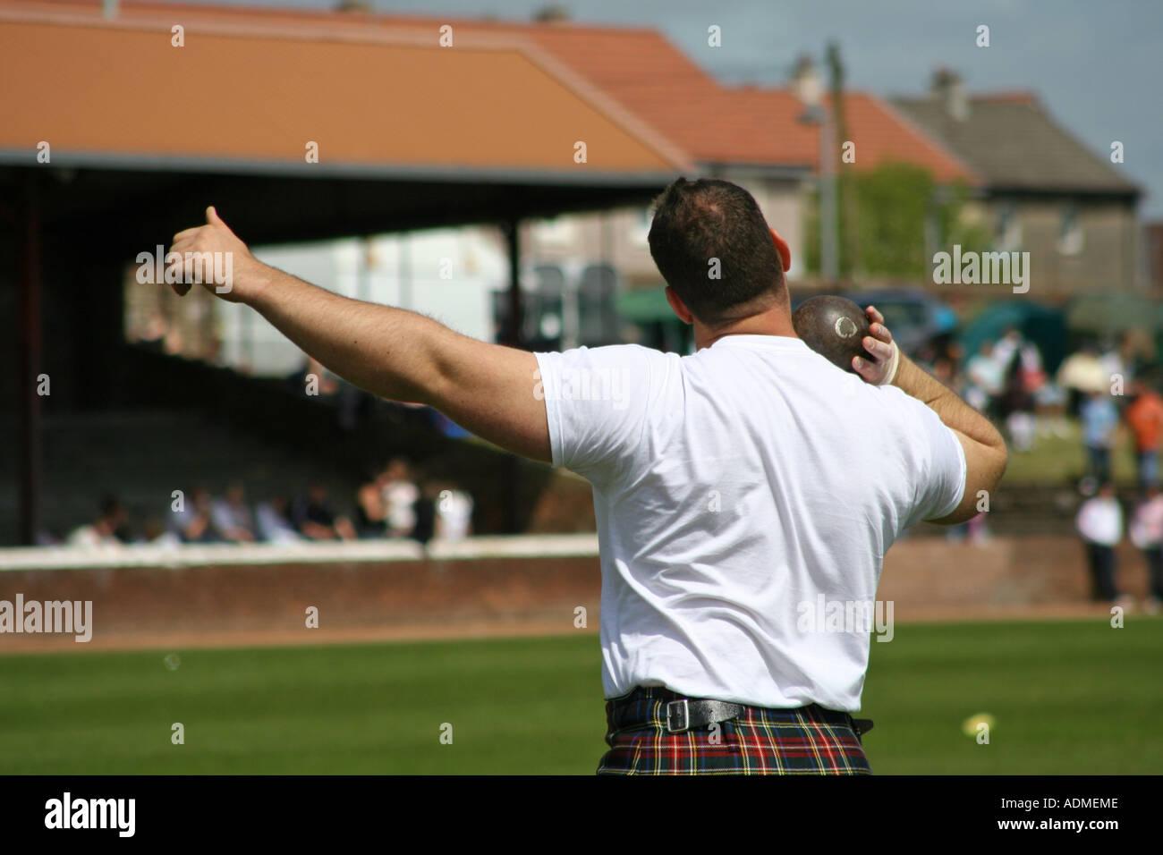 Putting the shot Shotts Highland Games Scotland UK - Stock Image