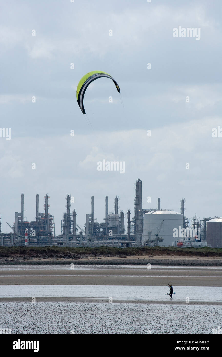 A kite surfer walks along the beach with his kite near Redcar Teesside Cleveland UK - Stock Image