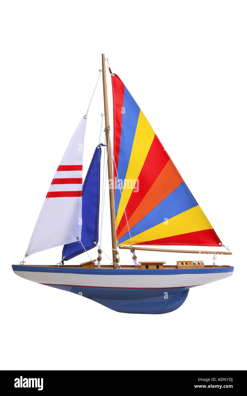 toy sail boat cut out on white background - Stock Image