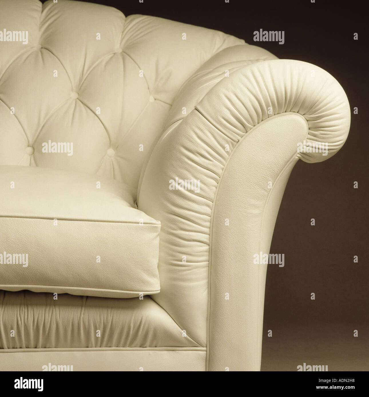 Close-up of white buttoned leather sofa - Stock Image