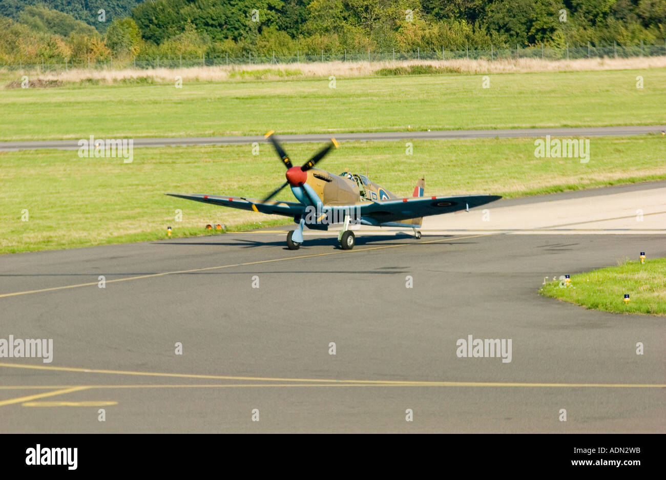 Supermarine Spitfire Mk Vb AB910 landing at Southampton Eastleigh Airport Hampshire England - Stock Image